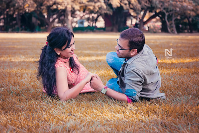A gorgeous couple before their wedding at a park spending some precious time.