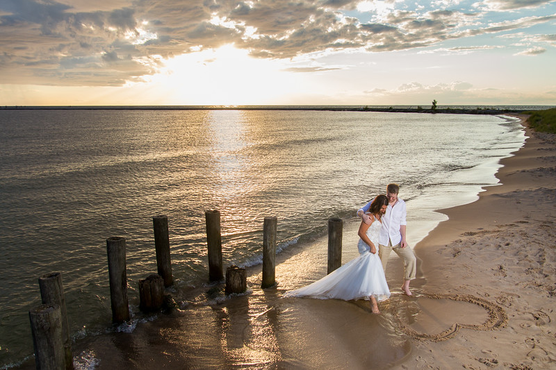 Such a fun idea! Showing their love for each other in the sand of their hometown beach.