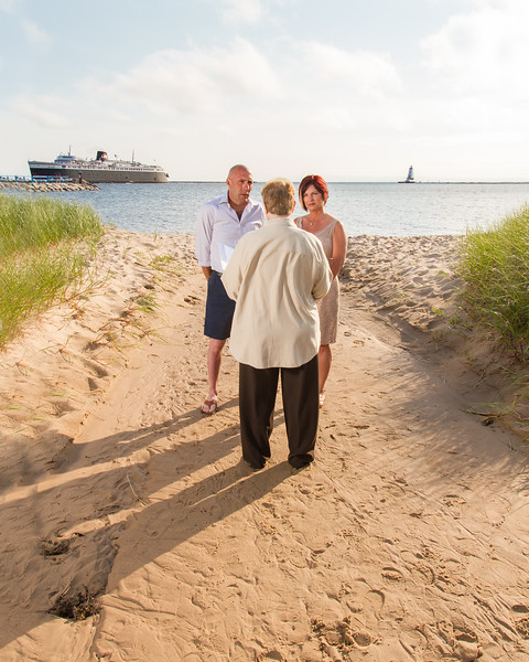 "Does it get more ""Ludington"" than this? Beautiful Lake Michigan water and sky, the awesome dunes on the lakeshore, and of course, the S.S. Badger and Lighthouse in the background. What an amazing location to renew your vows! :)"