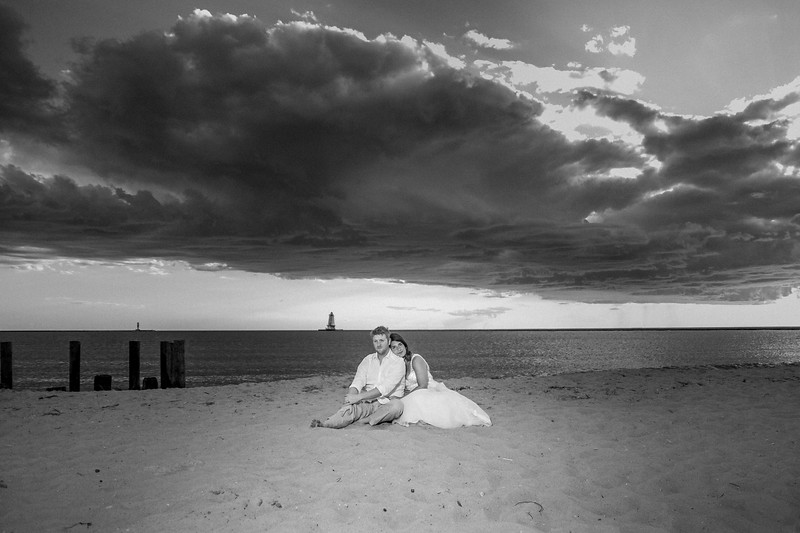 Something about this picture captivates me. Something about the massive cloud, the deserted beach, and these two amazing people in the middle of it all. Love this.