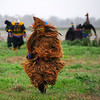 Costumed runners, also known as Mardi Gras, chase a chicken during Courir de Mardi Gras à Grand Mamou in Mamou, La., Tuesday, March 4, 2014. Participants continue the tradition of chasing chickens and traveling to local homes to gather ingredients for a community gumbo.