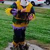 A costumed runner, also known as Mardi Gras, dances in a puddle of mud during the Courir de Mardi Gras à Grand Mamou in Mamou, La., Tuesday, March 4, 2014. Participants continue the tradition of chasing chickens and traveling to local homes to gather ingredients for a community gumbo.