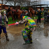 Costumed riders, also known as Mardi Gras, ride through town on horseback and participate in the Courir de Mardi Gras à Grand Mamou in  in Mamou, La., Tuesday, March 4, 2014. Participants continue the tradition of chasing chickens and traveling to local homes to gather ingredients for a community gumbo.
