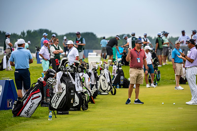 Tour Bags Line the Practice Green at the 2021 3M Open