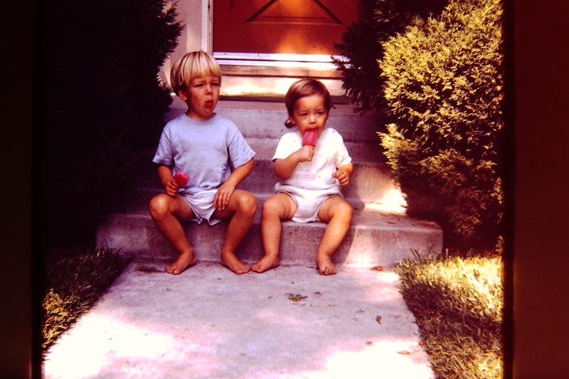 Jeremy and Joel eating pops on steps