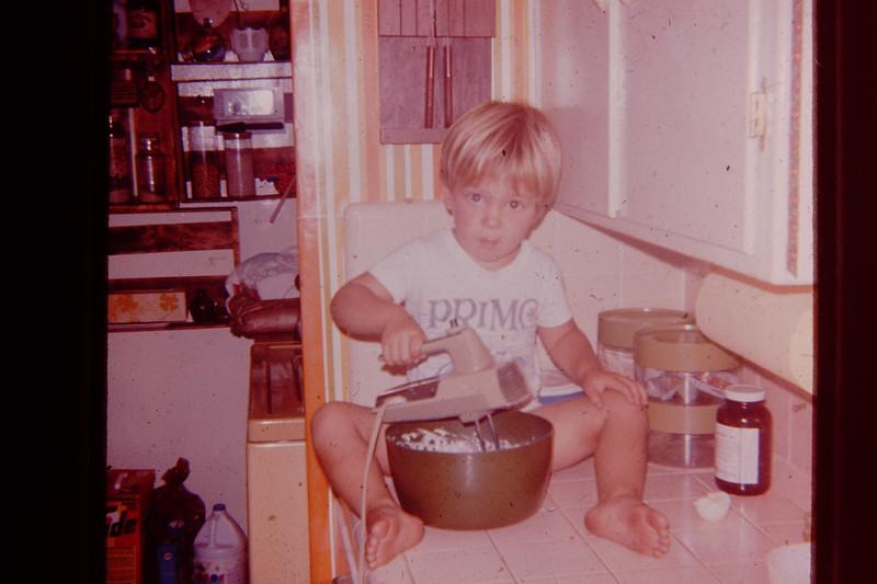 Joel making cupcakes