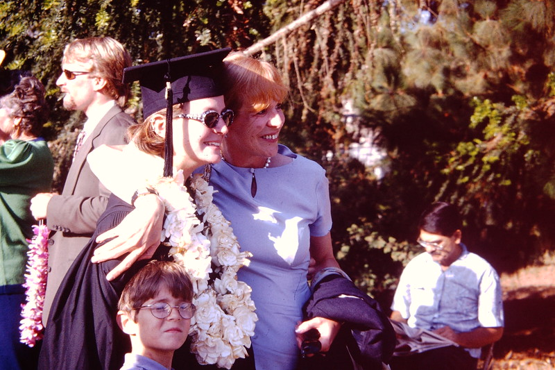 Juli and her mom at Graduation with lil Peter