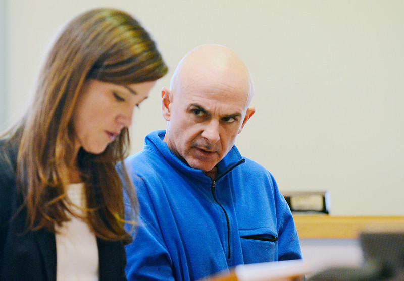 Jeff Cordio, owner of the West End Diner at 270 West St. in Leominster, talks to Attorney Andrea Levy during his arraignment in Leominster District Court, Tuesday, after he was arrested Monday night on arson charges.<br /> SENTINEL & ENTERPRISE / BRETT CRAWFORD