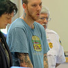 Daniel Brand, 34, of Leominster during court in Leominser at his arraignment on Monday morning. SENTINEL & ENTERPRISE/JOHN LOVE