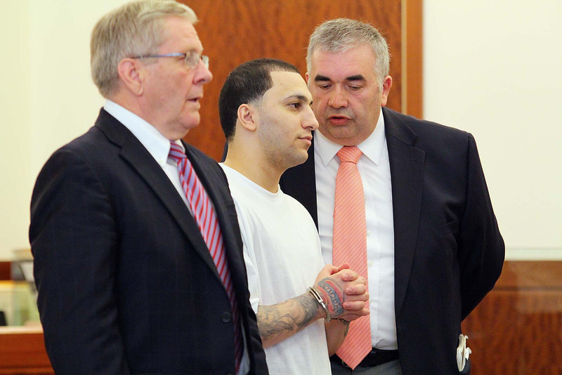 Jason Velez-Acosta was in Worcester Superior Court on Monday morning to change his plea to guilty on the murder of Scott Person two years ago in Fitchburg. With him is his Lawyer Geprge Murphy Jr. and an interpreter, on right. SENTINEL & ENTERPRISE/JOHN LOVE