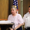 Rhonda Ravanis of Lunenburg was in Fitchburg District Court on Thursday for her arraignment on charges that she attacked her boyfriend with an ax. SENTINEL & ENTERPRISE/JOHN LOVE