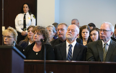 Relatives and friends of the Gustafson family listen as judge Helene Kazanjian goes through the reasoning in resentencing of Danial LaPlante to three consecutive life terms, at Middlesex Superior Court in Woburn. NOTE: second from left is Elizabeth Morgan Gustafson, sister of victim Priscilla Gustafson.  (SUN/Julia Malakie)