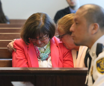Carole Gustafson, left, second wife of Andrew Gustafson, and unidentified woman react in Middlesex Superior Court in Woburn as Danial LaPlante is resentenced to three consecutive life terms in the 1987 murders of Andrew's first wife Priscilla Gustafson and their children, Abigail and William, in Townsend, Mass.  (SUN/Julia Malakie)