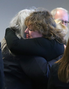 Elizabeth Morgan Williams, right, isister of Priscilla Gustafson, embraces assistant district attorner Adrienne Lynch, at Middlesex Superior Court in Woburn, after Daniel LaPlante was resentenced to three consecutive life terms in the 1987 murders of Gustafson and her two children, Abigail and William, in Townsend, Mass.  (SUN/Julia Malakie)