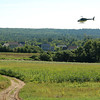 JBI Helicopter Services out of Pembroke N.H. drops a winter rye seeds as a winter cover crop when they flew over Hollis Hills Farm in Fitchburg on Thursday morning. SENTINEL & ENTERPRISE/JOHN LOVE