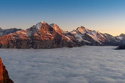 Sunset's final glow on peaks of the Berneralps, seen from the summit of Faulhorn. Switzerland.