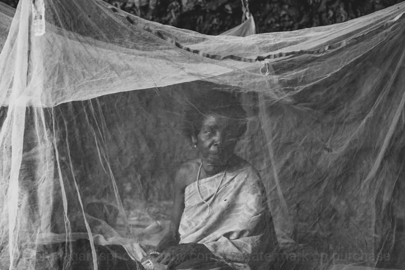 Vanuatu, Tanna, Iuwan, Woman and mosquito net in a cave