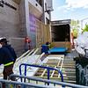 NEW YORK - May 7, 2020: for NEWS. Demolition contractors dismantle a morgue truck setup outside NYU Langone Orthopedic Hospital on 2nd Avenue, near Beth Israel Hospital, amid the COVID-19 Coronavirus pandemic. nypostinhouse (Photo by: Taidgh Barron/NY Post)