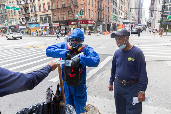 NEW YORK - July 7, 2020: for NEWS. Joseph Powell, of Flushing Queens, giving out PPE to essential workers for free to combat price gouging on masks and latex gloves as shopping activity around Macy's and 34th Street Herald Square returning to midtown amid phase 3 reopening from the COVID-19 coronavirus pandemic.   Nypostinhouse (Photo by: Taidgh Barron/NY Post)