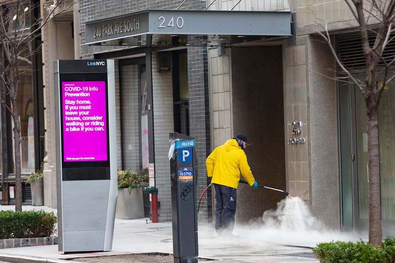 NEW YORK - March 18, 2020: for NEWS. Cleaners disinfecting the entrance to 240 Park Avenue South amid the COVID-19 Coronavirus Pandemic. (Photo by: Taidgh Barron/NY Post)