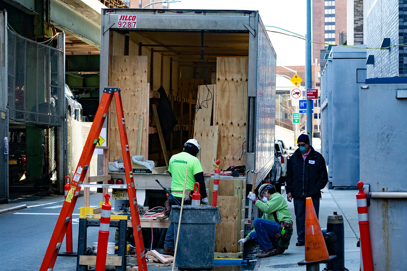 "NEW YORK - March 31, 2020: for NEWS. Construction workers converting refrigerated tractor trailers converted into makeshift morgues outside the Medical Examiners' Office at Bellevue Hospital amid the COVID-19 Coronavirus pandemic. ""New York workers are the best in the world and when the city needs us, we're here."" one construction worker who did not wish to be identified said.   nypostinhouse (Photo by: Taidgh Barron/NY Post)"