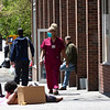 NEW YORK - May 7, 2020: for NEWS. A hospital worker passing a vagrant occupying the middle of the sidewalk on 1st Avenue across from Bellevue Hospital during the lunch break amid the COVID-19 Coronavirus pandemic. nypostinhouse (Photo by: Taidgh Barron/NY Post)