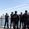 `NEW YORK - April 28, 2020: for NEWS. FDNY EMS EMTs and Paramedics in Stuyvesant Cove on the East River watch the U.S. Navy Blue Angels and U.S. Air Force Thunderbirds demonstration teams conduct a flyover to salute first responders amid the COVID-19 Coronavirus pandemic. nypostinhouse (Photo by: Taidgh Barron/NY Post)
