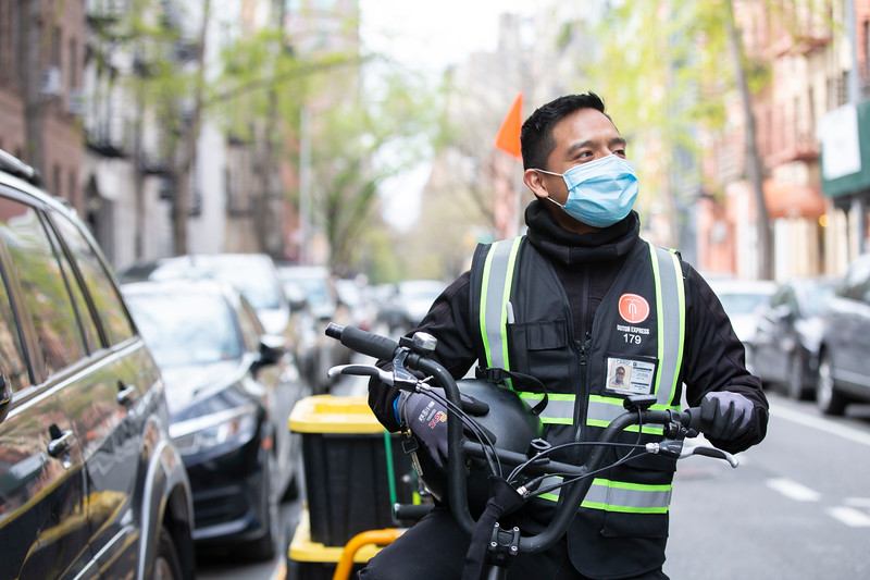 NEW YORK - April 14, 2020: for NEWS. Hero of the Day bike courier Eduardo Rojas, 25, of Hunts Point in the Bronx, making Whole Foods grocery deliveries on the Upper East Side for Dutch Express Couriers amid the COVID-19 Coronavirus pandemic. nypostinhouse (Photo by: Taidgh Barron/NY Post)