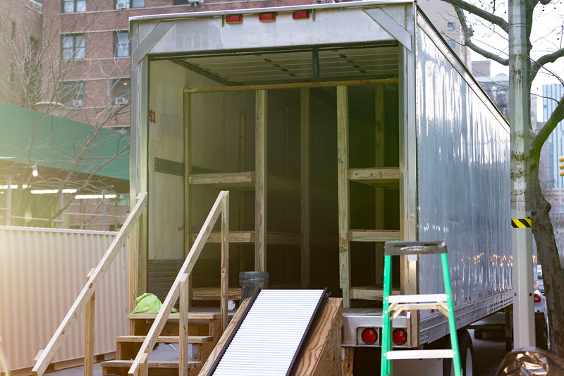 NEW YORK - March 30, 2020: for NEWS. A refrigerated trailer being converted into a morgue by construction workers installing makeshift wooden shelving at Bellevue Hospital amid the COVID-19 Coronavirus pandemic. nypostinhouse (Photo by: Taidgh Barron/NY Post)