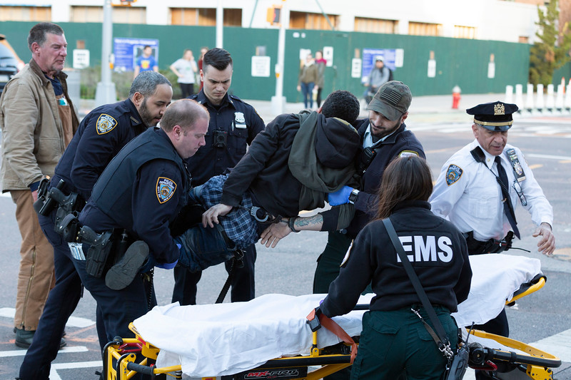 NEW YORK - March 27, 2020: for NEWS. Mount Sinai EMS and Police struggle a resisting EDP who was found parked in the middle of East 20th Street in a sedan pointed the wrong way amid the COVID-19 Coronavirus pandemic. nypostinhouse (Photo by: Taidgh Barron/NY Post)