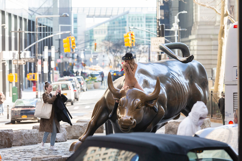 NEW YORK - March 26, 2020: for NEWS. A nude woman rides the Charging Bull at Bowling Green during a shelter in place order requiring everyone stay home except for essential travel amid the COVID-19 coronavirus outbreak. nypostinhouse (Photo by: Taidgh Barron/NY Post)