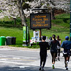 NEW YORK - April 7, 2020: for NEWS. Runners in Central Park ignoring social distancing jogging past an NYPD sign calling for social distancing on a nice weather day amid the COVID-19 Coronavirus pandemic. nypostinhouse (Photo by: Taidgh Barron/NY Post)