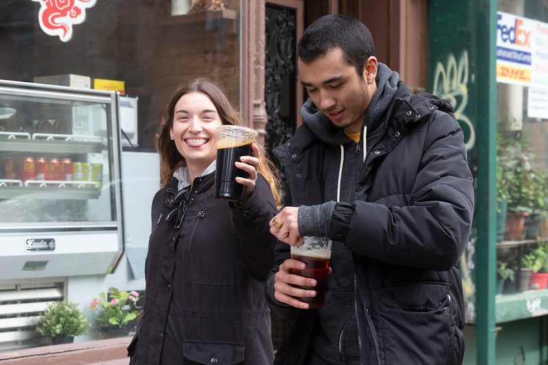 NEW YORK - March 17, 2020: for NEWS. Two patrons of McSorely's Old Ale House in the East Village walking down East 7th Street with their takeout dark ale amid the COVID-19 Coronavirus pandemic.  (Photo by: Taidgh Barron/NY Post)