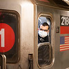 NEW YORK - March 31, 2020: for NEWS. A train conductor for the 1 train Broadway line wearing a mask as he closes the train doors at Times Square - 42nd Street MTA subway station amid the COVID-19 Coronavirus pandemic. nypostinhouse (Photo by: Taidgh Barron/NY Post)