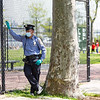 NEW YORK - May 15, 2020: for NEWS. A School Safety Agent keeping guard in social distancing enforcement in John V. Lindsay East River Park in the Lower East Side  during an 80 degree day amid the COVID-19 coronavirus pandemic.  nypostinhouse (Photo by: Taidgh Barron/NY Post)