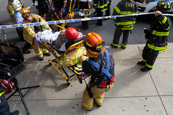 NEW YORK - July 16, 2020: for NEWS. FDNY firemen and NYPD Emergency Service Unit ESU respond to a building collapse onto a scaffolding as workers were on the scaffolding, killing one, critically injuring two and minor injuries to another amid phase 3 reopening from the COVID-19 coronavirus pandemic.    Nypostinhouse (Photo by: Taidgh Barron/NY Post)