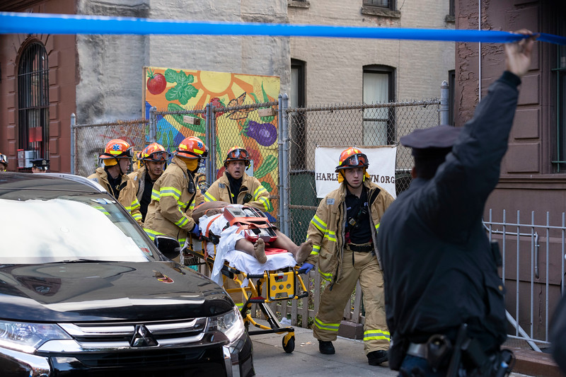 NEW YORK - October 18, 2019: for NEWS.  EMS evacuating an injured man to an ambulance during a 2-alarm fire on W 131st Street in Harlem. (Photo by Taidgh Barron/NY POST)