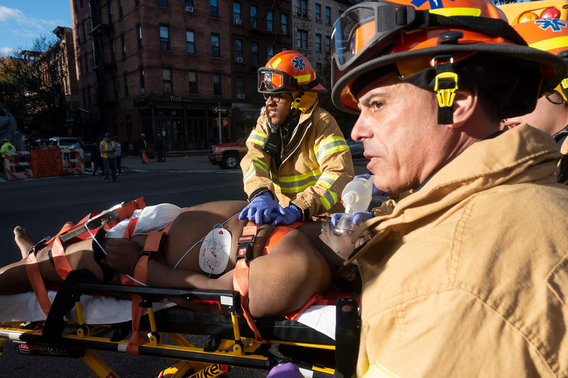 NEW YORK - October 18, 2019: for NEWS.  EMS preforming CPR compressions on a man injured during a 2-alarm fire on W 131st Street in Harlem. (Photo by Taidgh Barron/NY POST)