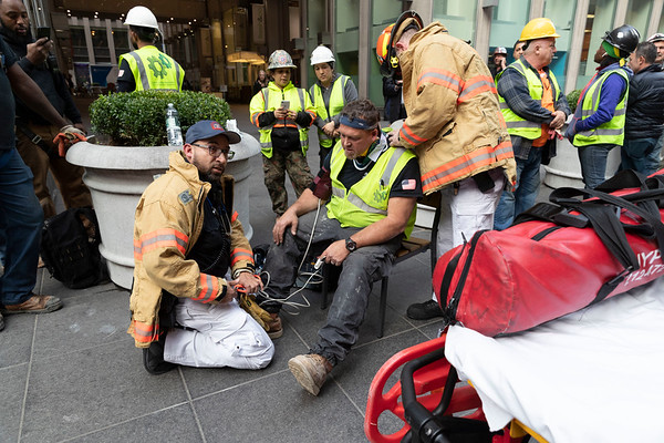 NEW YORK - October 10, 2019: for NEWS. EMS treats a construction worker injured in a generator explosion on 47th Street between 6th and 7th Avenues. (Photo by Taidgh Barron/NY POST)