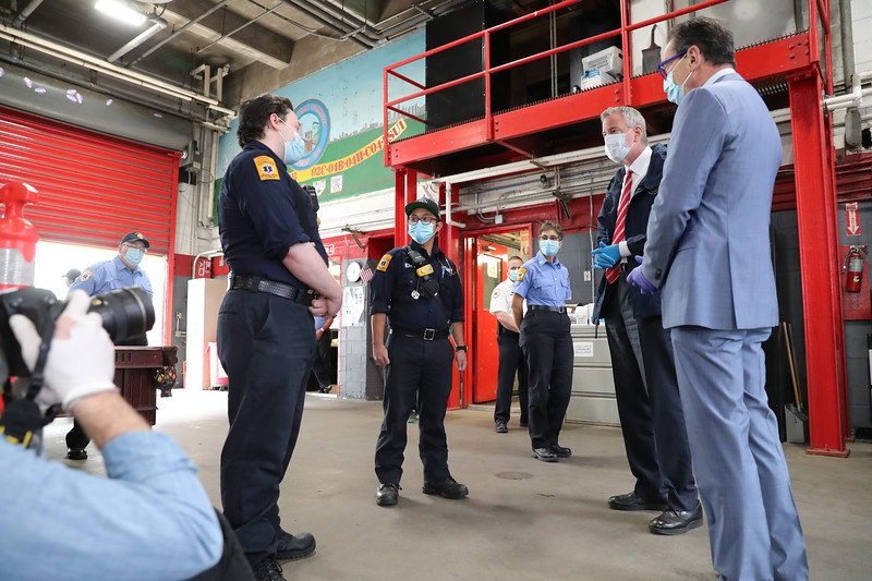 NEW YORK - May 4, 2020: for NEWS. Mayor Bill de Blasio and Fire Commissioner Daniel Nigro talk to EMTs during a visit FDNY EMS Station 4 on South Street in the Lower East Side to deliver food to the EMTs and Paramedics in the station amid the COVID-19 coronavirus pandemic. nypostinhouse (Credit: Taidgh Barron/NY Post)
