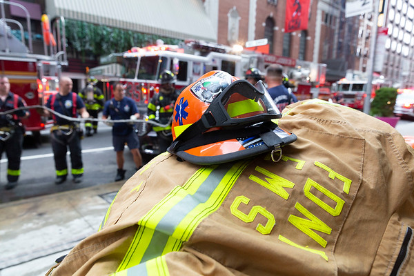 NEW YORK - July 24, 2020:  FDNY firefighters take up after putting out a fire in Victor's Kitchen on West 52nd Street in Hell's Kitchen around the Theater District during the phase 4 reopening from the COVID-19 coronavirus pandemic.