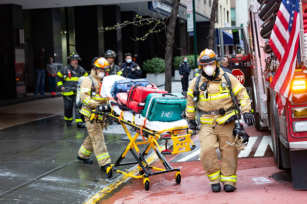 NEW YORK - April 23, 2020: for NEWS. FDNY EMS Rescue Medic Paramedics donning N95 masks respond to a high rise fire at 245 E 40th Street Murray Hill Towers amid the COVID-19 Coronavirus pandemic. nypostinhouse (Photo by: Taidgh Barron/NY Post)