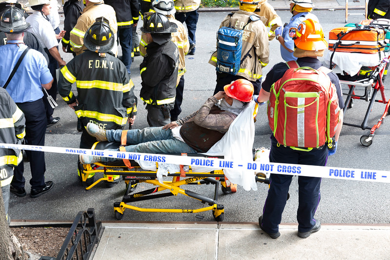 NEW YORK - July 16, 2020: for NEWS. A worker crying as FDNY firemen and NYPD Emergency Service Unit ESU respond to a building collapse onto a scaffolding as workers were on the scaffolding, killing one, critically injuring two and minor injuries to another amid phase 3 reopening from the COVID-19 coronavirus pandemic.    Nypostinhouse (Photo by: Taidgh Barron/NY Post)