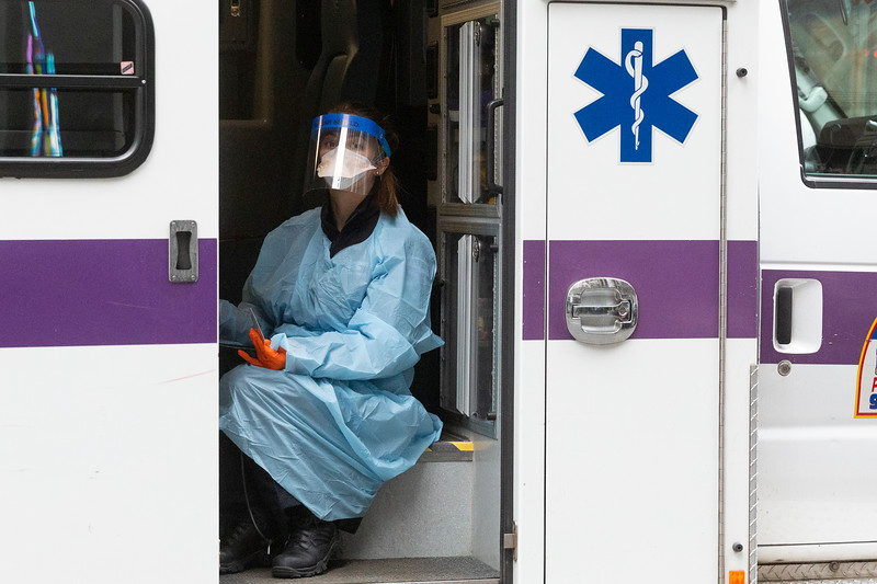 NEW YORK - March 10, 2020: for NEWS. An NYU Langone Health Center 911 EMT on West 43rd Street and 6th Avenue donning a gown and faceplate while transporting a patient  amidst the COVID-19 Coronavirus outbreak.(Photo by: Taidgh Barron/NY Post)