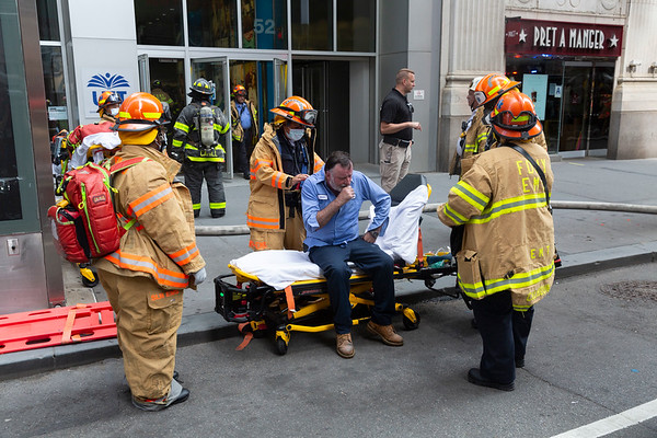 NEW YORK - June 19 2020: for NEWS. EMS treats a building working for smoke inhalation as FDNY firefighters battle a stubborn high rise fire on the 24th floor of 52 Broadway, the UFT building, in the Financial District.  Nypostinhouse (Photo by: Taidgh Barron/NY Post)