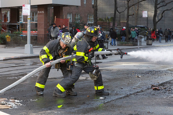 NEW YORK - February 17, 2020: for NEWS. Firemen from Engine 26 take up from a dumpster fire on W 58th Street and 9th Avenue in Midtown North. (Photo by: Taidgh Barron/NY Post)