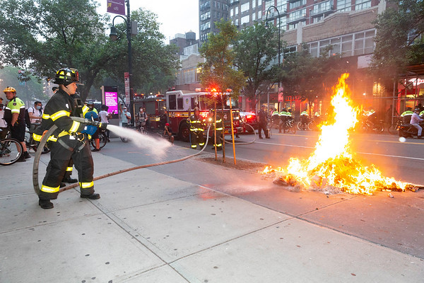 NEW YORK - May 30, 2020: for NEWS. FDNY firemen work at extinguishing fires lit by rioters on East 14th Street near Union Square as riots against the NYPD in Manhattan after protests against the police involved death of George Floyd in Minneapolis turned violent amid the COVID-19 coronavirus pandemic.  nypostinhouse (Photo by: Taidgh Barron/NY Post)