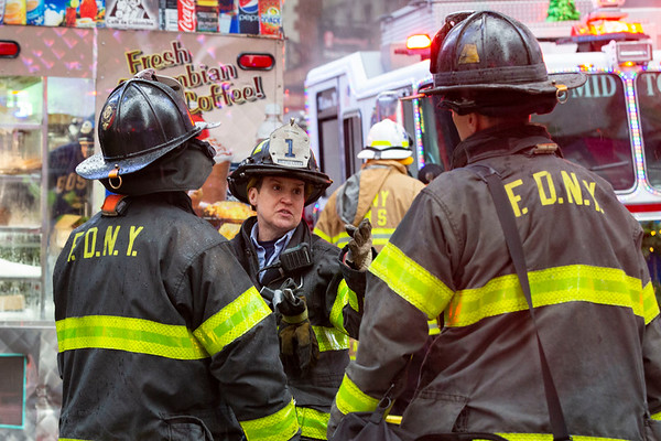 NEW YORK - December 17, 2019: for NEWS. Rescue 1 Lieutenant Adrienne Walsh responding to the scene of where Erica Tishman was struck and killed by falling debris from 729 7th Avenue as she was walking on W 49th Street. (Photo by Taidgh Barron/NY Post)