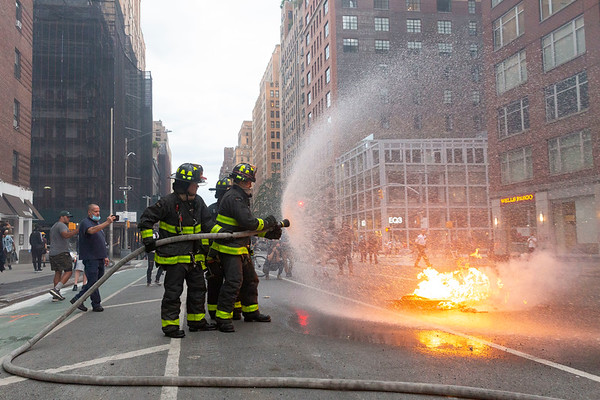 NEW YORK - May 30, 2020: for NEWS.  Firemen put out fires on 7th Avenue as riots against the NYPD in Manhattan broke out after protests against the police involved death of George Floyd in Minneapolis turned violent amid the COVID-19 coronavirus pandemic.  nypostinhouse (Photo by: Taidgh Barron/NY Post)