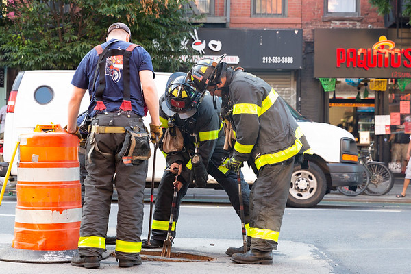 NEW YORK - June 24 2020: for NEWS. FDNY Firemen with Tower Ladder Company 9 (Ladder 9) investigate a call of a manhole fire on 1st Avenue in the East Vilage amid phase 2 reopening from the COVID-19 coronavirus pandemic. Nypostinhouse (Photo by: Taidgh Barron/NY Post)